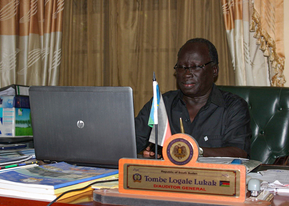 Deputy Auditor General Hon Tombe Lukak  in the Juba office