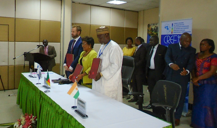 Signing ceremony with representatives from IDI, SAI Eritrea, and AFROSAI-E